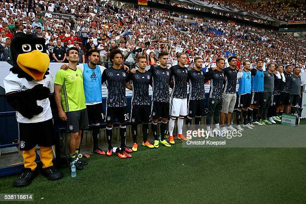 The players of germany from the substitute bench stay together for the national anthem prior to the International Friendly match between Germany and...