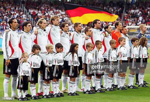 The players of Germany sing the national anthem prior to the UEFA EURO 2008 qualifier between Germany and San Marino at the Easy Credit Stadium on...