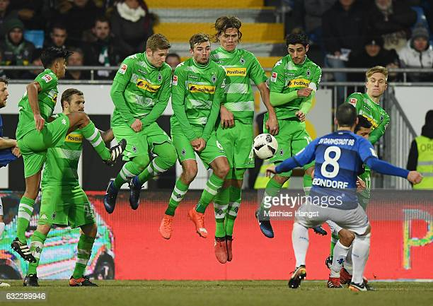 The players of Gladbach block a free-kick of Jerome Gondorf of Darmstadt during the Bundesliga match between SV Darmstadt 98 and Borussia...