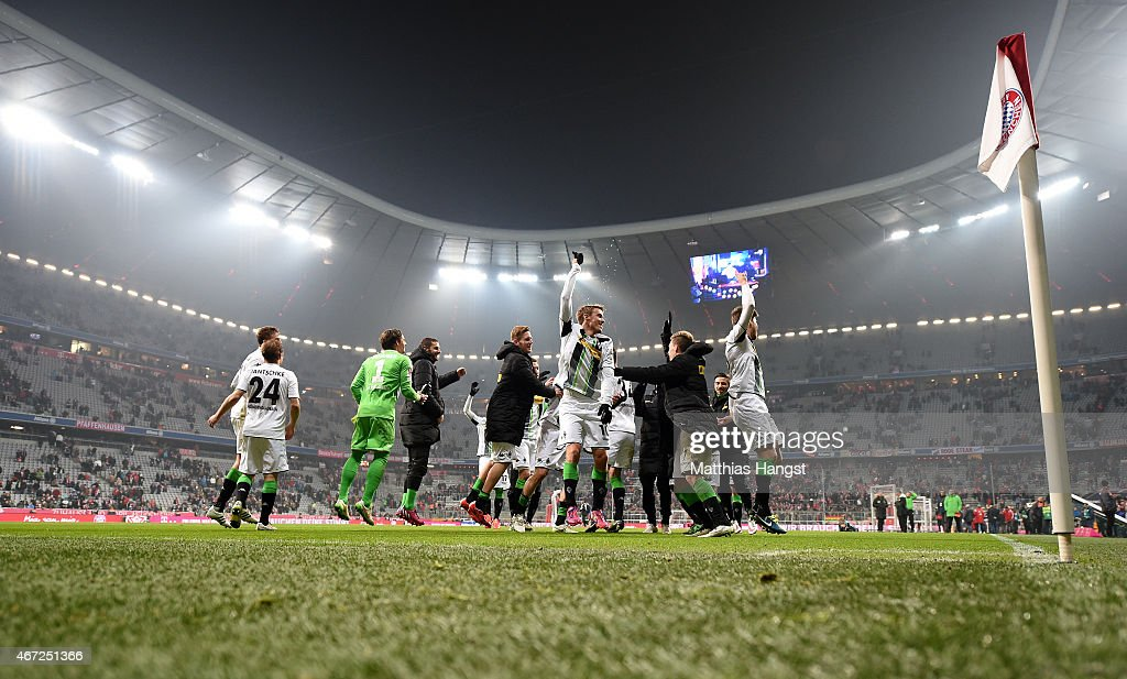 The players of Gladbach celebrate with their fans after the Bundesliga match between FC Bayern Muenchen and Borussia Moenchengladbach at Allianz Arena on March 22, 2015 in Munich, Germany.