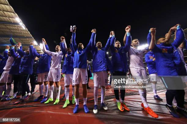 The players of Greece celebrate in front of their greek fans after the FIFA 2018 World Cup Group H Qualifier match between Belgium and Greece at...