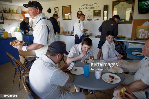 The players of Hambledon and Mansbridge having tea in the pavilion during their Hampshire League match at the Ridge Meadow ground near Hambledon...