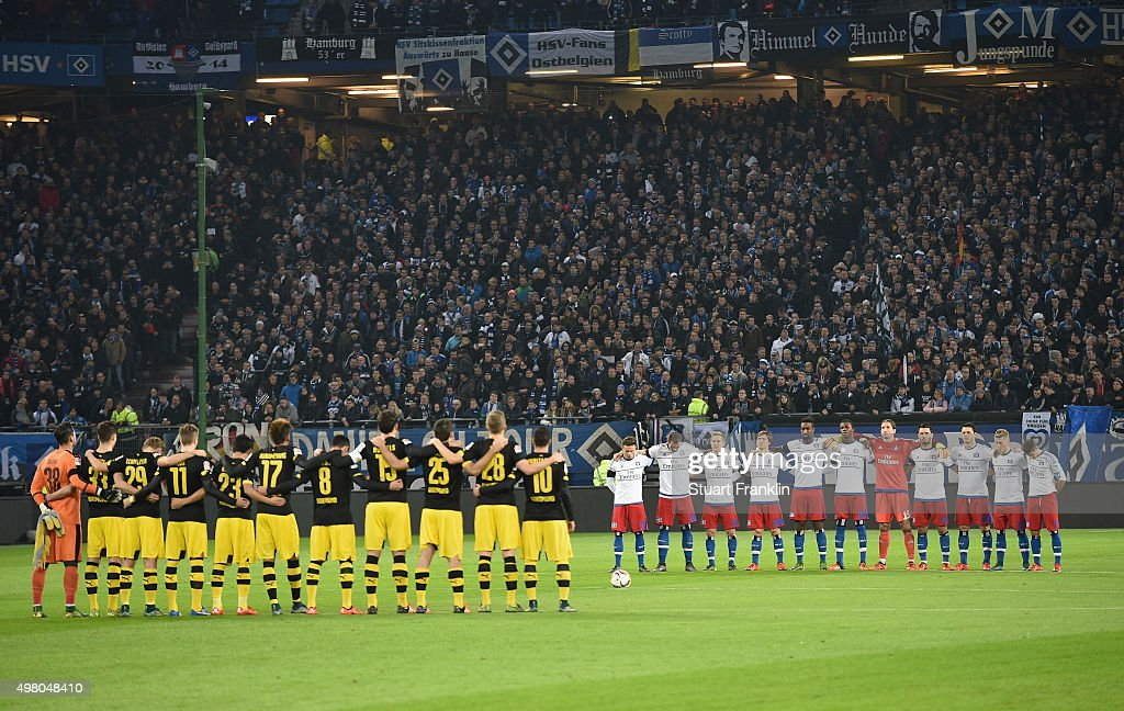 The players of Hamburg and Dortmund observe a minutes silence in memeory of tyhe 129 victims killed by terrorist in Paris before the Bundesliga match between Hamburger SV and Borussia Dortmund at Volksparkstadion on November 20, 2015 in Hamburg, Germany.