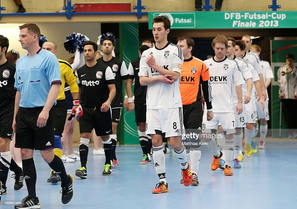 The players of Hamburg and Muenster enter the field prior to the DFB Futsal Cup final match between Hamburg Panthers and UFC Muenster at Sporthalle Wandsbek on April 6, 2013 in Hamburg, Germany.