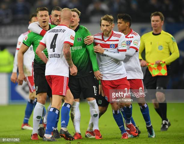 The players of Hamburg and of Hannover discuss during the Bundesliga match between Hamburger SV and Hannover 96 at Volksparkstadion on February 4...