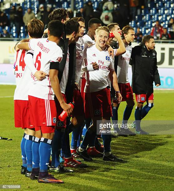 The players of Hamburg celebrat at the end of the Bundesliga match between SV Darmstadt 98 and Hamburger SV at Stadion am Boellenfalltor on December...
