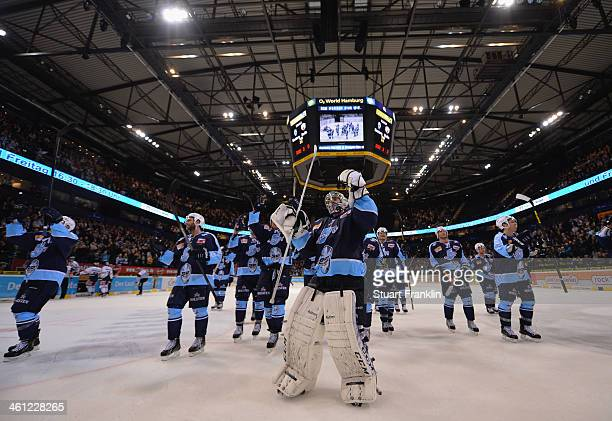 The players of Hamburg celebrate getting to the top of the league after winning the DEL ice hockey match between Hamburg Freezers and Eisbaeren...