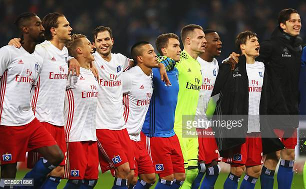 The players of Hamburg celebrate their win at the end of the Bundesliga match between Hamburger SV and FC Augsburg at Volksparkstadion on December 10...