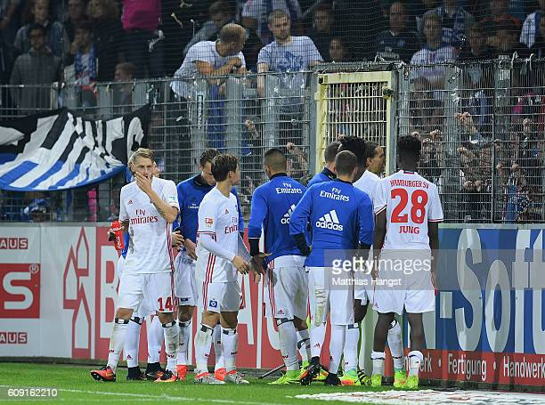 The players of Hamburg discuss with the fans after the Bundesliga match between SC Freiburg and Hamburger SV at SchwarzwaldStadion on September 20...