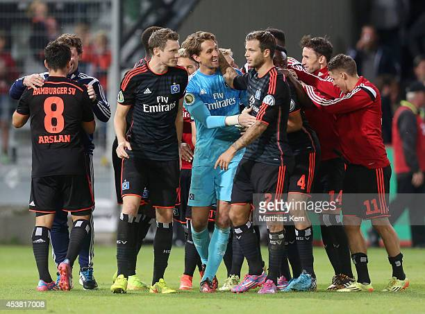 The players of Hamburg show their delight after winning the DFB Cup match between FC Energie Cottbus and Hamburger SV at Stadion der Freundschaft on...