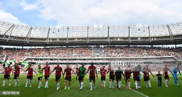 The players of Hannover celebrate promotion after the Second Bundesliga match between Hannover 96 and VfB Stuttgart at HDIArena on May 14 2017 in...