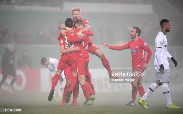 The players of Heidenheim celebrate after winning the DFB Cup match between 1. FC Heidenheim and Bayer Leverkusen at Voith-Arena on February 05, 2019...