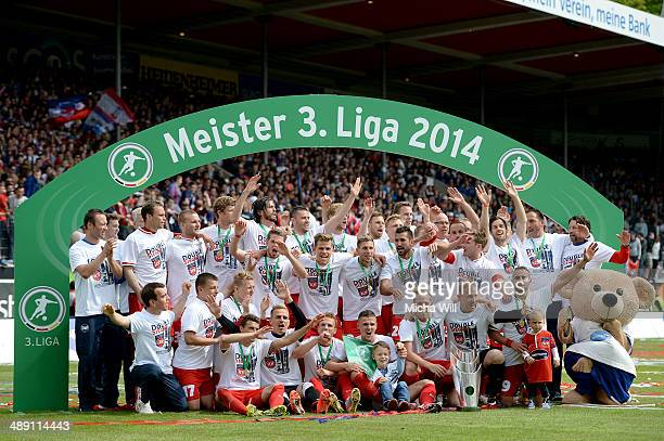 The players of Heidenheim celebrate the championship title win of the Third League at Voith-Arena on May 10, 2014 in Heidenheim, Germany.