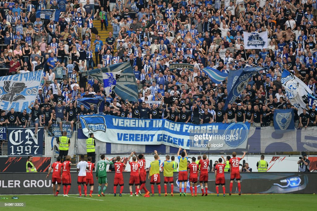 The players of Hertha BSC celebrate the 0:3 away victory with the fans after the match between Eintracht Frankfurt and Hertha BSC at the Commerzbank-Arena on April 21, 2018 in Frankfurt, Germany.