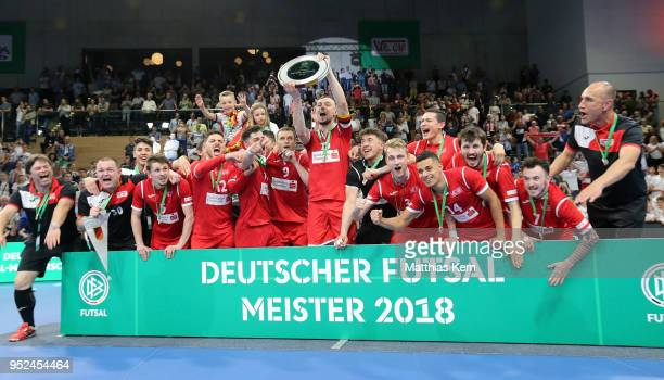 The players of Hohenstein Ernstthal celebrate with the trophy after winning the German Futsal Championship final match between VfL...