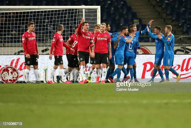 The Players of Holstein Kiel celebrate after scoring during the Second Bundesliga match between Hannover 96 and Holstein Kiel at HDI-Arena on March...