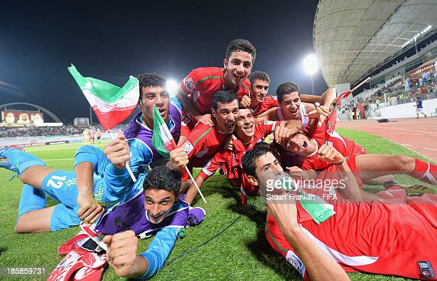 The players of Iran celebrate at the end of the FIFA U 17 World Cup group E match between Austria and Iran at Khalifa Bin Zayed Stadium on October...