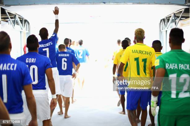 The players of Italy and of Brazil walk out of the players tunnel prior to the FIFA Beach Soccer World Cup Bahamas 2017 semi final match between...
