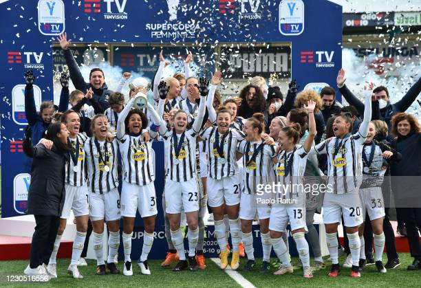 The players of Juventus team celebrate after winning the Cup during the Women's Super Cup Final match between Juventus and ACF Fiorentina at Stadio...