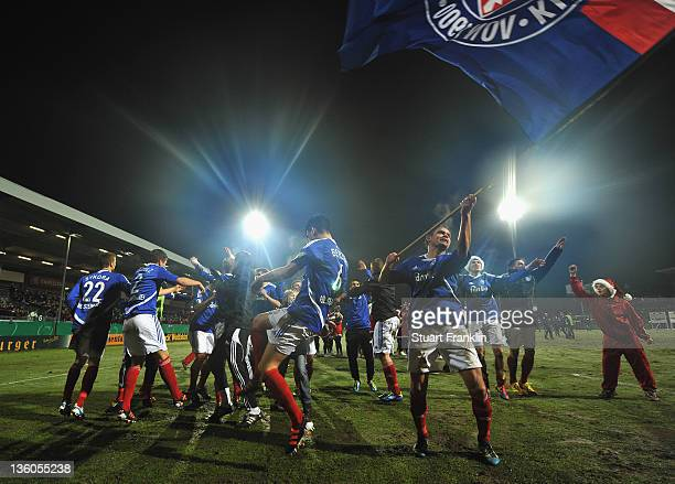 The players of Kiel celebrate winning their the DFB cup round of sixteen match between Holstein Kiel and Mainz 05 at the HolsteinStadion on December...