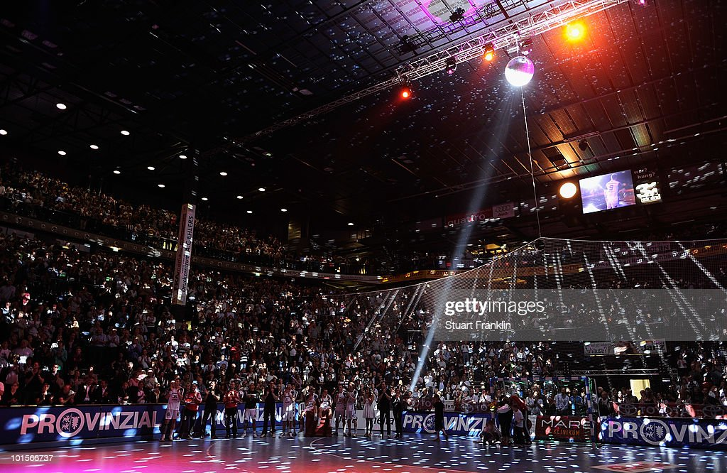 The players of Kiel soak up the atmosphere at the end of the Toyota Handball bundesliga match between THW Kiel and HBW Balingen-Weilstetten at the Sparkassen Arena on June 2, 2010 in Kiel, Germany.