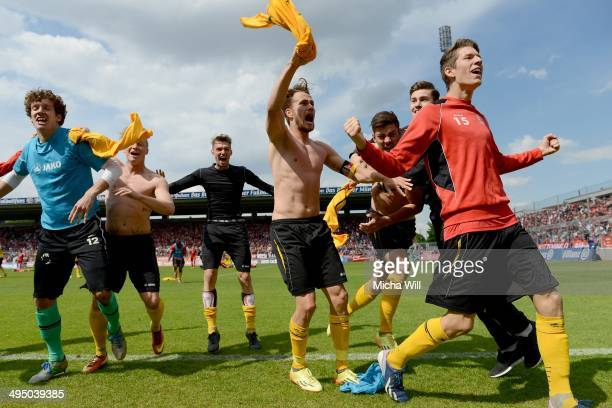 The players of Koeln celebrate after winning the relegation between Bayern Muenchen II and Fortuna Koeln at Stadion An Der Gruenwalder Strasse on...