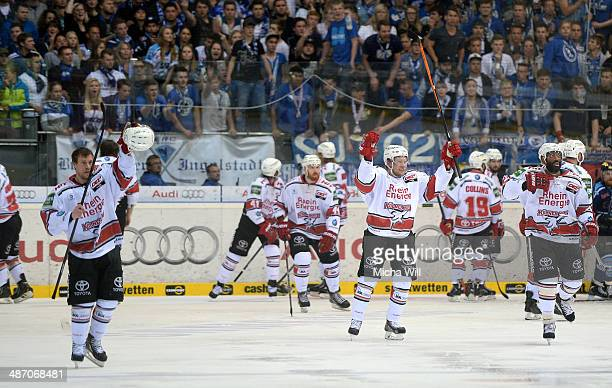 The players of Koeln celebrate their victory after game six of the DEL final playoffs between ERC Ingolstadt and Koelner Haie at Saturn Arena on...