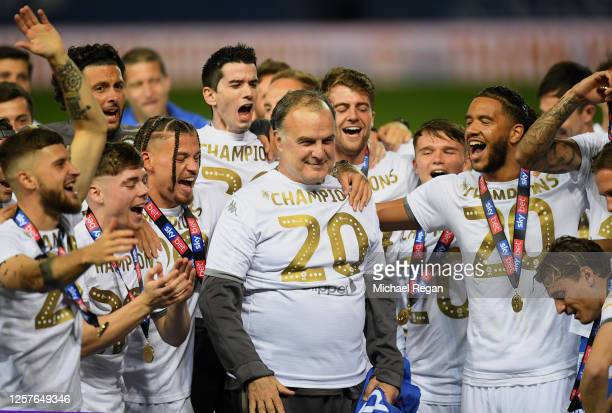 The players of Leeds celebrate their manager Marcelo Bielsa with the trophy during the Sky Bet Championship match between Leeds United and Charlton...