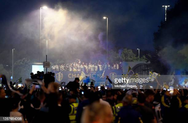 The players of Leeds celebrate with the trophy on a bus outside the stadium after the Sky Bet Championship match between Leeds United and Charlton...