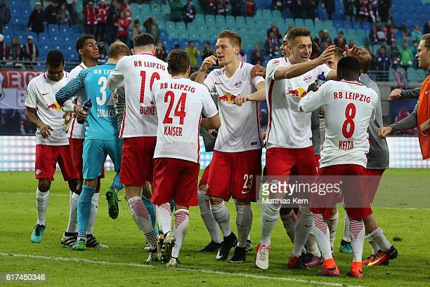 The players of Leipzig celebrate after winning the Bundesliga match between RB Leipzig and SV Werder Bremen at Red Bull Arena on October 23 2016 in...