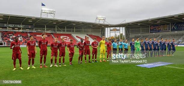 The players of Liverpool and of FK Crvena Zvezda line up with the match officials before the UEFA Youth League game at Langtree Park on October 24,...