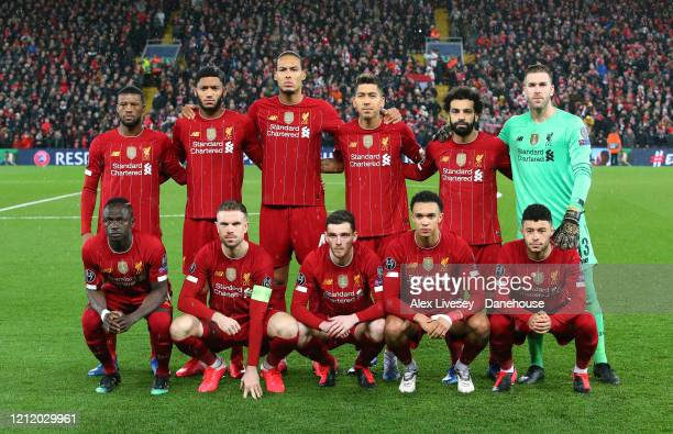 The players of Liverpool line up prior to the UEFA Champions League round of 16 second leg match between Liverpool FC and Atletico Madrid at Anfield...