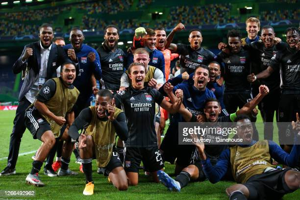 The players of Lyon celebrate after victory in the UEFA Champions League Quarter Final match between Manchester City and Lyon at Estadio Jose...