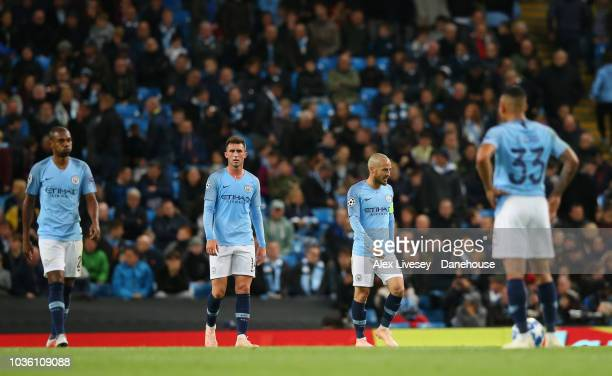 The players of Manchester City look dejected after conceding the opening goal during the Group F match of the UEFA Champions League between...