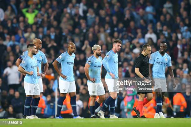The players of Manchester City look on as referee Cunyet Cakir checks VAR before awarding a goal for Fernando Llorente of Tottenham Hotspur during...