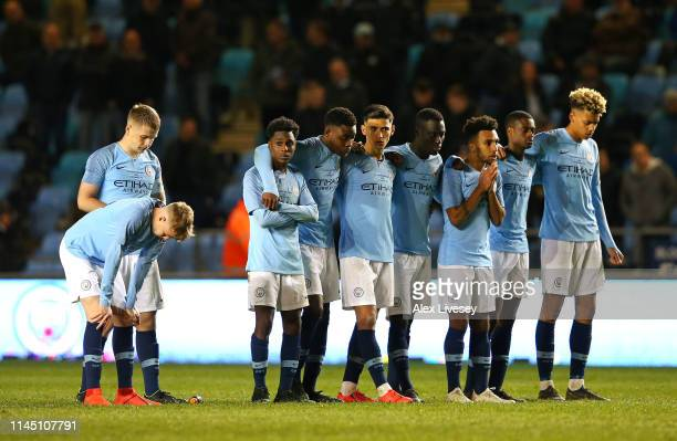 The players of Manchester City look on during their defeat in a penalty shoot out in the FA Youth Cup Final between Manchester City and Liverpool at...