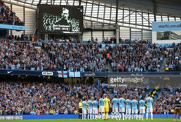 The players of Manchester City stand for a one minutes applause in memory of former player Bert Trautmann prior to the Barclays Premier League match...