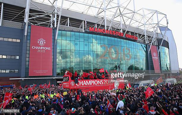 The players of Manchester United leave Old Trafford on an open top bus to start the Manchester United Premier League Winners Parade on May 13 2013 in...