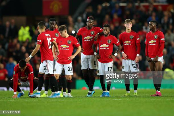 The players of Manchester United stand for the penalty shoot out during the Carabao Cup Third Round match between Manchester United and Rochdale AFC...