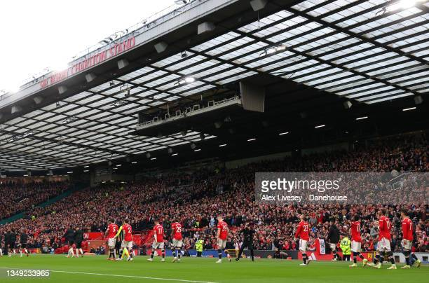 The players of Manchester United walk out for the Premier League match between Manchester United and Liverpool at Old Trafford on October 24, 2021 in...