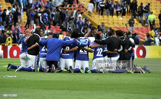The players of Millonarios celebrate at the end of the match between Millonarios and Deportes Tolima as part of Postobon Leguaje II 2013 at Nemesio...