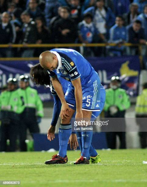 The Players of Millonarios react after losing during a match between Millonarios FC and Atletico Junior as part of the second leg of the Liga...
