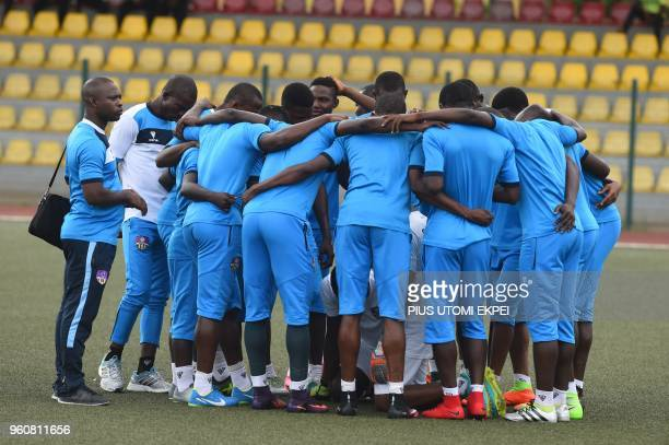 The players of Mountain of Fire and Miracles Ministries football club stand together to pray before a continental match at Agege Stadium in Lagos on...