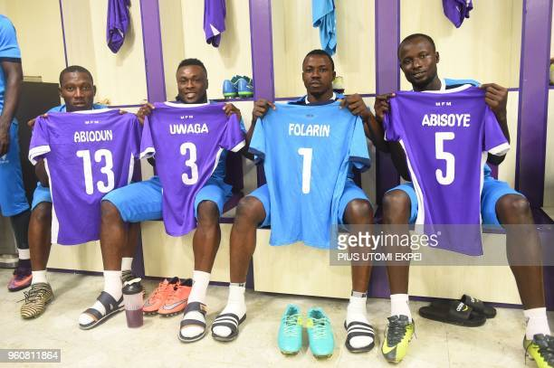 The players of Mountain of Fire and Miracles Ministries football club display jerseys in the changing room before a continental match at Agege...