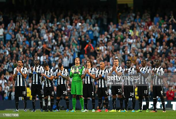 The players of Newcastle United stand for a one minutes applause in memory of former Manchester City player Bert Trautmann prior to the Barclays...