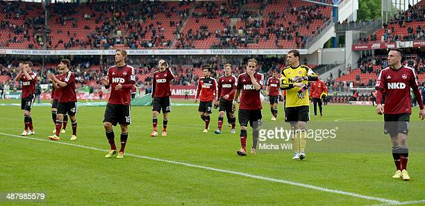 The players of Nuernberg bid goodbye to their fans after the Bundesliga match between 1 FC Nuernberg and Hannover 96 at Grundig Stadium on May 3 2014...