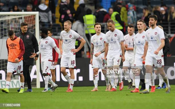 The players of Nuernberg show their disappointment walking off the pitch after the Bundesliga match between Eintracht Frankfurt and 1 FC Nuernberg at...