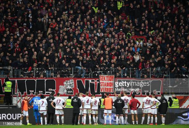 The players of Nuernberg stand in front of their fans after the Bundesliga match between Eintracht Frankfurt and 1 FC Nuernberg at CommerzbankArena...