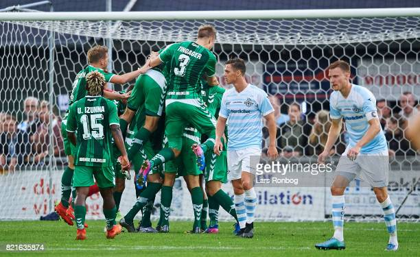 The players of OB Odense celebrate after the 10 goal scored by Anders K Jacobsen during the Danish Alka Superliga match between FC Helsingor and OB...