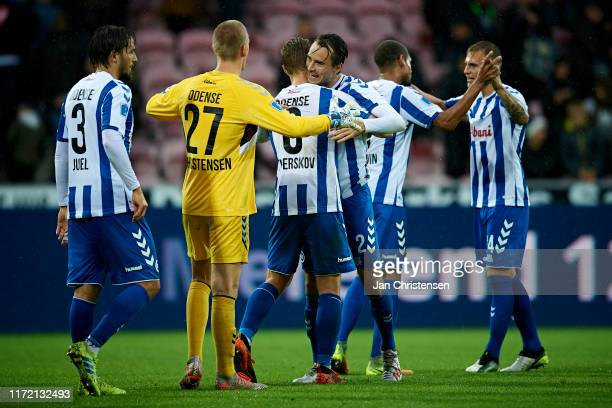 The players of OB Odense celebrate after the Danish 3F Superliga match between FC Midtjylland and OB Odense at MCH Arena on September 29, 2019 in...